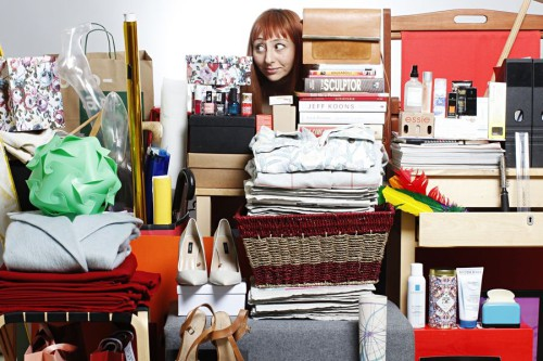 eva wiseman peeps out from behind her pile of 'stuff'